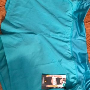 Running shorts with zipper in back Never been worn